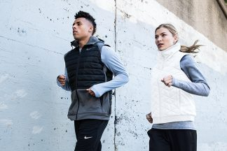 man and woman running wearing winter running clothes