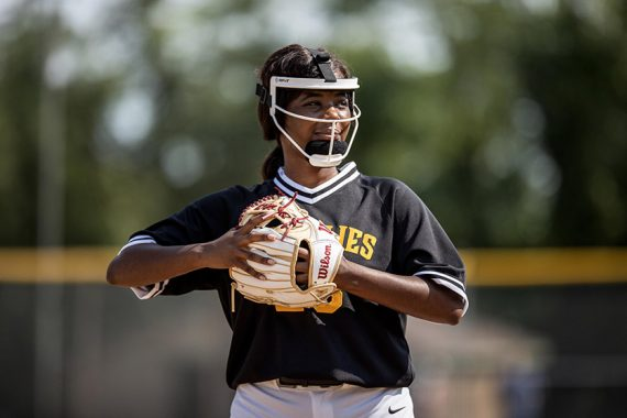 Softball player in the infield with her Wilson A2000 Series softball glove