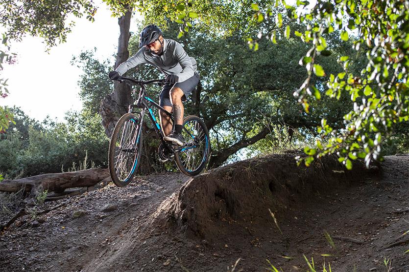 man riding a mountain bike on a trail