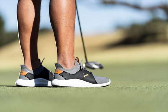 golfer wearing PUMA Ignite Fasten8 golf shoes on the course